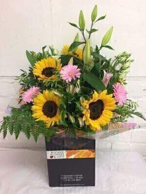 <h2>Yellow and Pink Flowers Bouquet in Box</h2><br><br> <h3>Liverpool Flower Delivery</h3><br><br> We offer advanced booking flower delivery same day flower delivery 3 hour Flower delivery guaranteed AM PM or Evening Flower Delivery and we are now offering Sunday Flower Delivery.<br><br><ul><li>Hand arranged by our florists</li><li> To give the best occasionally we may make substitutes </li><li>Our flowers backed by our 7 days freshness guarantee</li><li> Approximate dimensions 60x35cm </li><li> This product is only available for delivery Liverpool areas that we would cover ourselves. So postcodes beginning with L1 L2 L3 L4 L5 L6 L7 L8 L11 L12 L13 L14 L15 L16 L17 L18 L19 L24 L25 L26 L27 L36 L70 </li></ul><br><br> THIS PRODUCT COMES HAND ARRANANGED AND GIFT WRAPPED IN A WATER BUBBLE PRESENTED IN A BOX This Bouquet includes lots of the feature flowers Sunflowers the cheery yellow combined with other pretty pink flowers gives a real summery feel.<br><br> Featuring Sunflowers lilies gerberas and alstromeria all hand arranged by our skilled florists at Booker Flowers and Gifts with lots of luscious greenery. The lilies in the picture are closed however once open this bouquet will look twice the size.<br><br> <h3>The best florist in Liverpool</h3><br><br> Come to Booker Flowers and Gifts Liverpool for your Beautiful Flowers and Plants if you really want to spoil we also have a great range of Wines Champagne Balloons Vases and Chocolates that can be delivered with your flowers. To see the full range see our extras section. You can trust Booker Flowers and Gifts can deliver the very best for you
