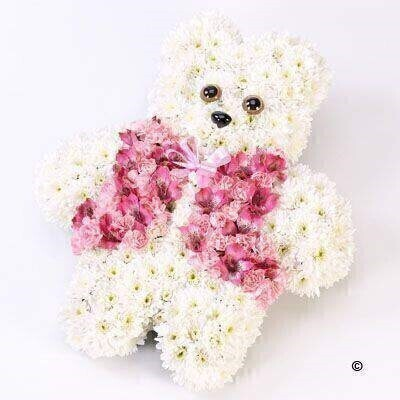 Double spray chrysanthemums - spray carnations and alstroemeria are used to create this pink and white design shaped like a teddy bear.