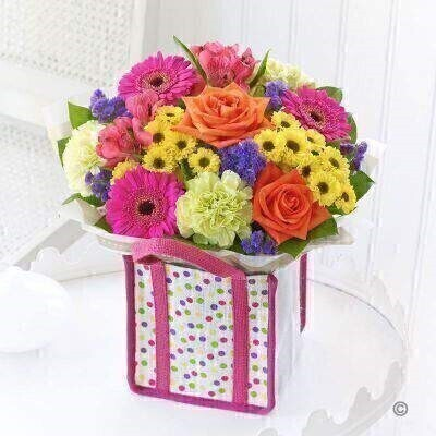 THIS ARRANGEMENT IS DONE IN FLORAL FOAM AND COMES PRE ARRANGED IN THE BAG FOR DISPLAY