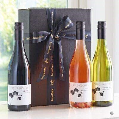 THIS PRODUCT CONTAINS ALCOHOL AND AS SUCH SHOULD ONLY BE BOUGHT FOR SOMEONE OVER THE AGE OF 18 If they enjoy a glass of good wine theyandacirc;andeuro;andtrade;ll be delighted with this beautifully presented gift box. Weandacirc;andeuro;andtrade;ve chosen a rich red a refreshing rose and a crisp white andacirc;andeuro;andldquo; each with its own distinctive flavour and aroma. Theyandacirc;andeuro;andtrade;ll soon be raising a glass to toast you and your kindness. Featuring Wild Orchid Merlot 75cl Wild Orchid Rose 75cl and Wild Orchid Chenin Blanc 75cl presented in a matt black gift box lined with shredded tissue paper and trimmed with Interflora ribbon.
